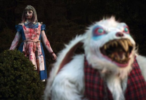 "A costumed performer dressed as Alice in Wonderland poses with the White Rabbit during the ""Halloween Horror Party 2012"" at the  Movie Park Germany in the western city of Bottrop"